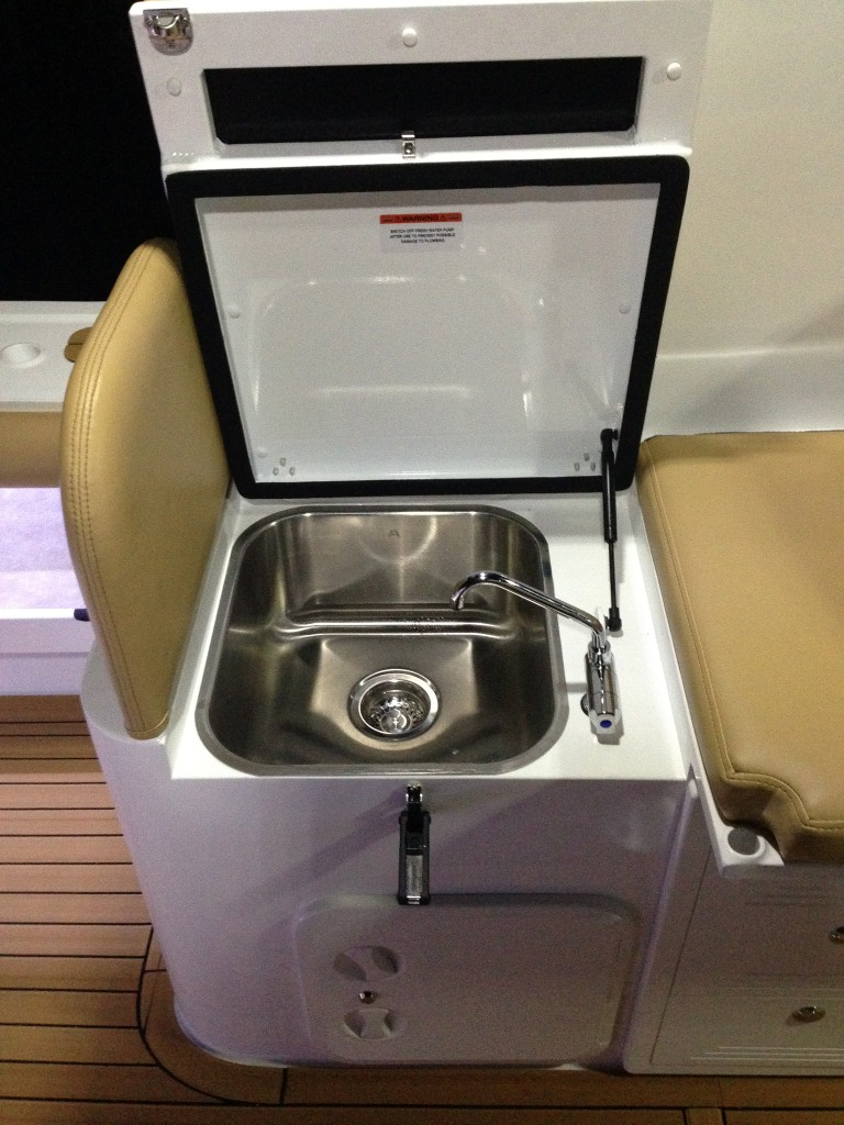 Large sink and folding tap